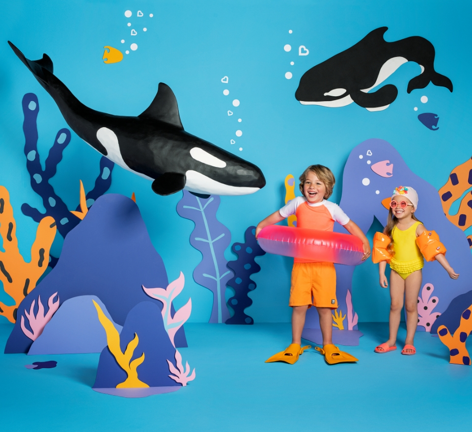 Kids Playing with Orca in Ocean Cover Image